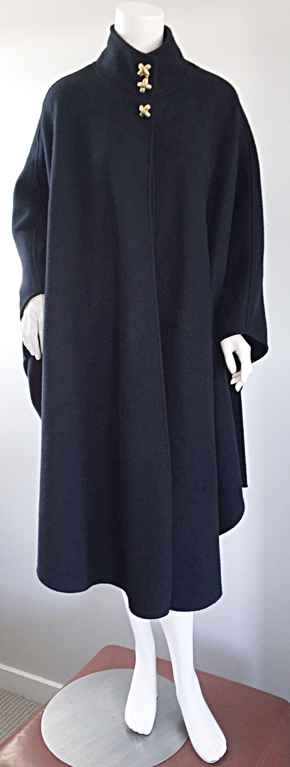 "Fantastic vintage Lord & Taylor black fleece cape! Great shape, with gold ""X"" buttons, that resemble Paloma Picasso. The perfect winter staple that is so easy to layer, and can easily be worn with jeans or a dress. In great condition. Will fit size"