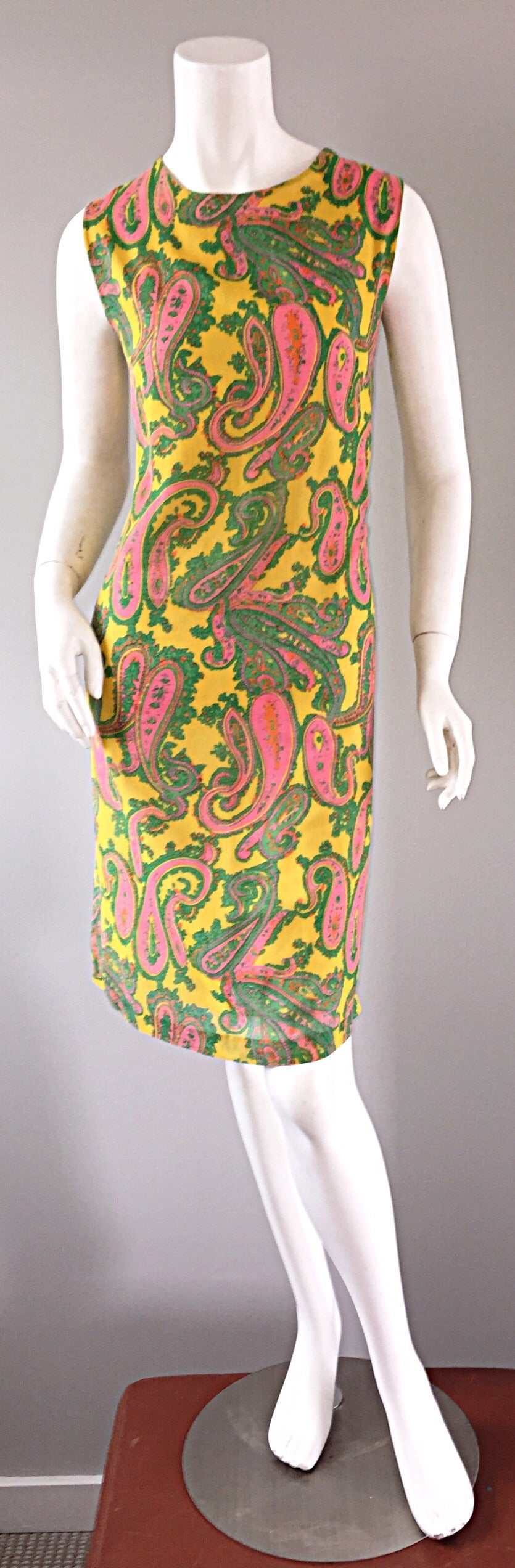 Awesome 1960s cotton shift dress! Vibrant yellow, with green and pink paisley print throughout. Wonderful 'shift' shape, that flatters every shape and size! Fully lined in lightweight cotton. Full metal zipper up the back. Looks great alone, or