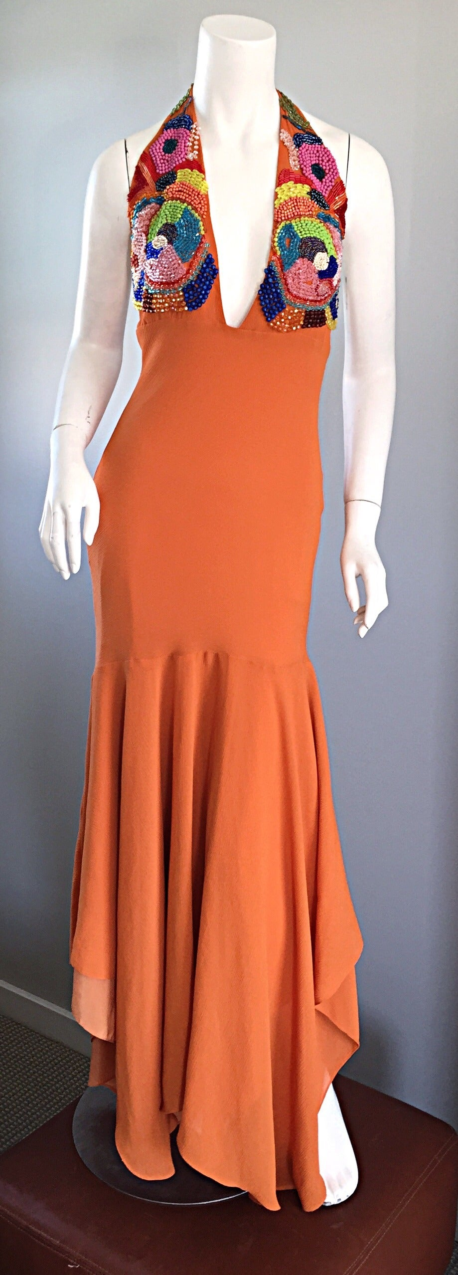 Sexy 90s vintage beaded halter gown / maxi dress!! Orange silk crepe material, that literally flows when on the body! Intricate beaded bodice. Halter style neck. Asymmetrical hem. A definite head turner, that looks amazing on the dance floor.