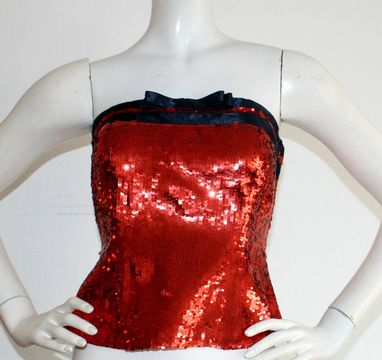 Ravishing vintage Bill BLass sequin bustier, brand new with tages still attached from Neiman Marcus! Sparkle in the all-over red sequin number, complete with a black silk bow. Fully lined. Perfect for your Holiday/New Years Party! In great