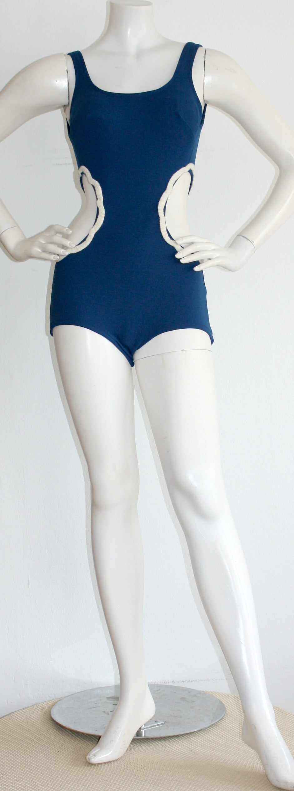Incredibly chic vintage Oleg Cassini one-piece cut-out 1960s swimsuit. Features cut-outs at either side of the waist, to exude a fit silhouette. Beautiful royal blue color. Perfect for the pool or beach. In great condition. Approximately Size