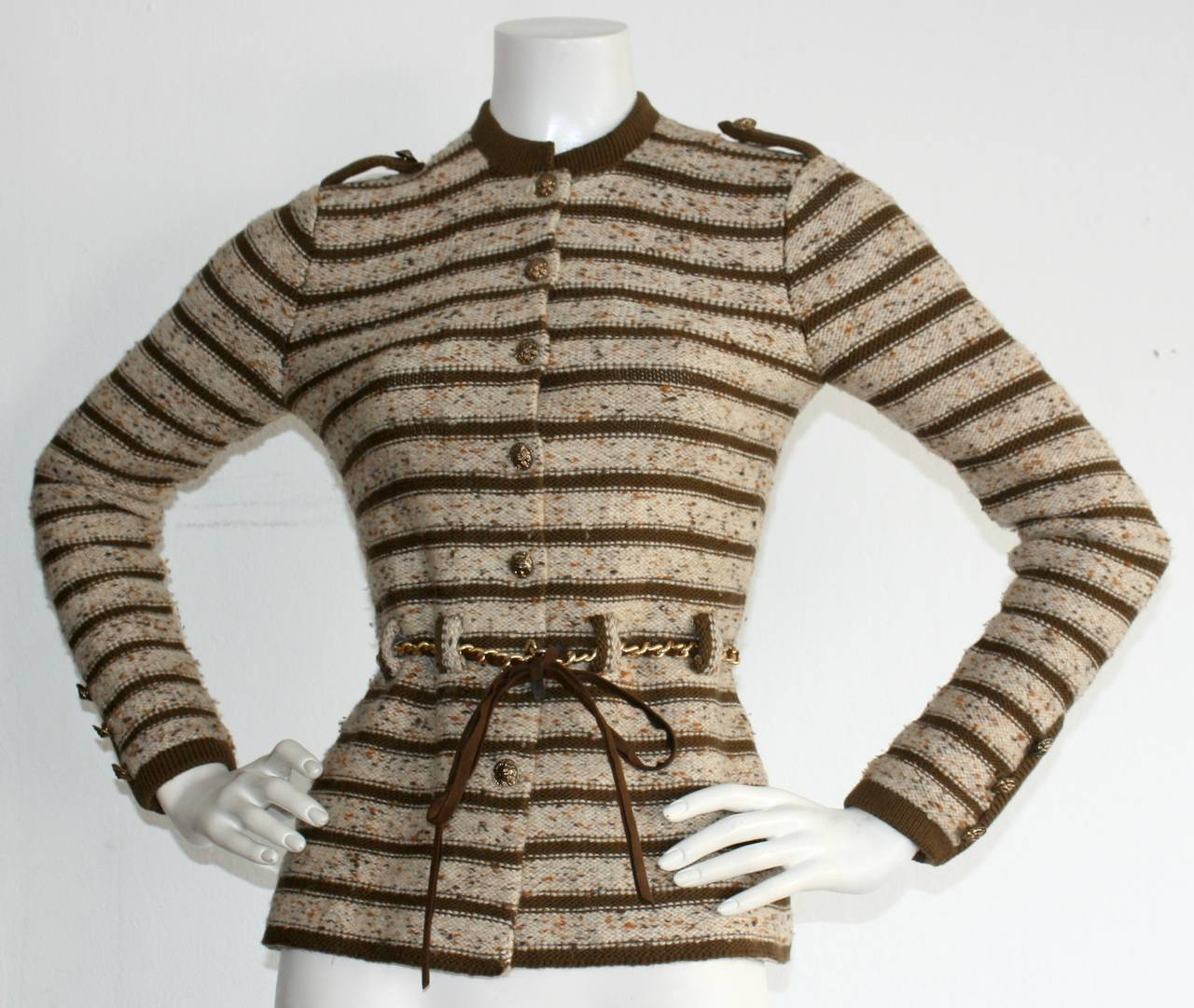 Absolute Chic vintage Adolfo for Saks 5th Ave. cardigan, with matching gold chain belt, interlaced with brown suede. Intricate brass buttons up the front, and at shoulders. Can easily be dressed up, or down. In great condition. Approximately Size