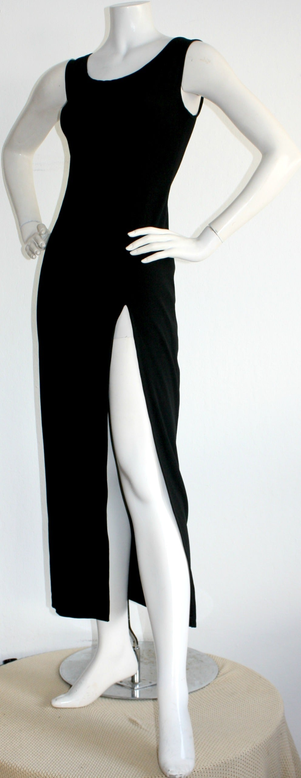 Sexy 1990s Vintage Jean Paul Gaultier Black dress w/ High Slit In Excellent Condition For Sale In San Francisco, CA