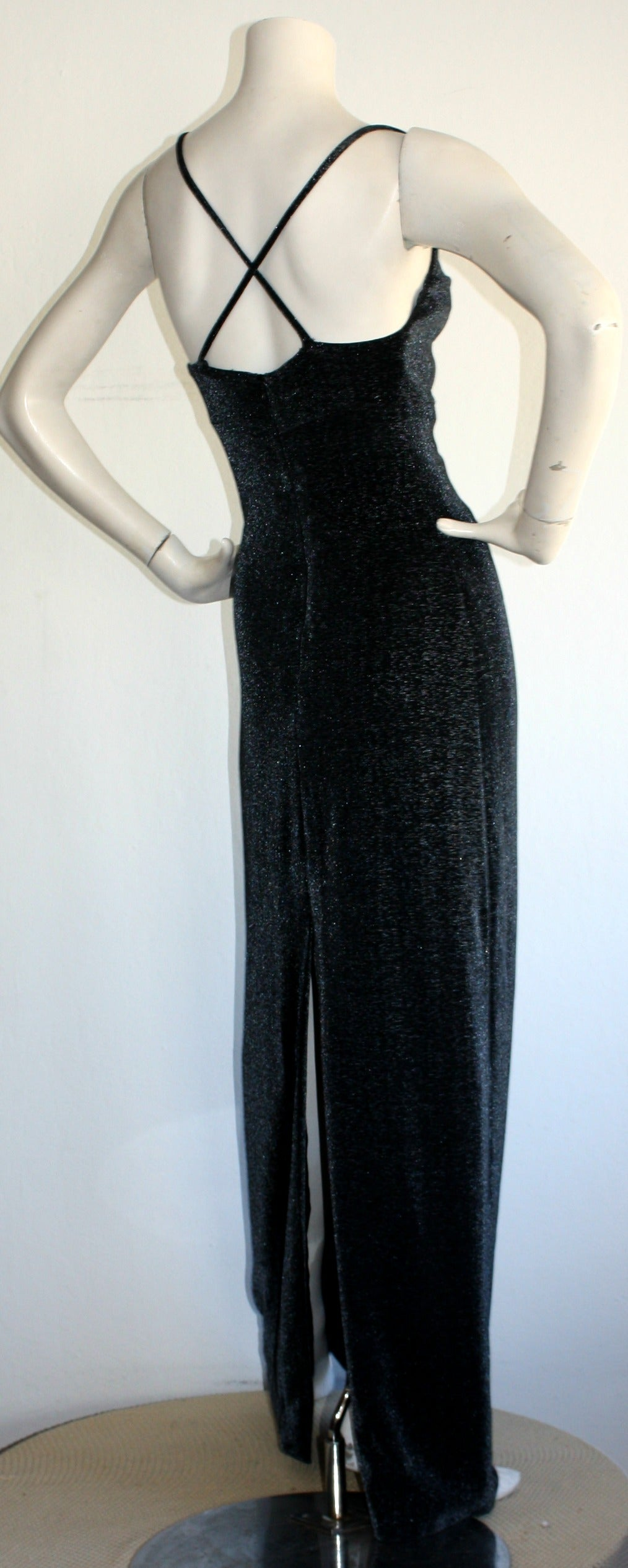 Stunning vintage Gianni Versace 'Versus' gown! Beautiful black/gray/silver metallic stretch material, with striking criss-cross back straps. Amazing construction, with a chic, flattering fit! Fully lined. In great condition. Marked Size EU