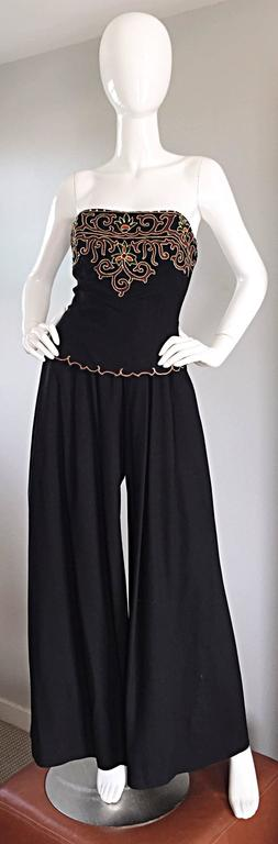Exceptional, and super rare vintage PIERRE BALMAIN black strapless jumpsuit! Wonderful wide leg palazzos, that are so flattering, and uber chic! Regal hand embroidery at bodice, adorned with rhinestones at top edge. Bodice is also boned for