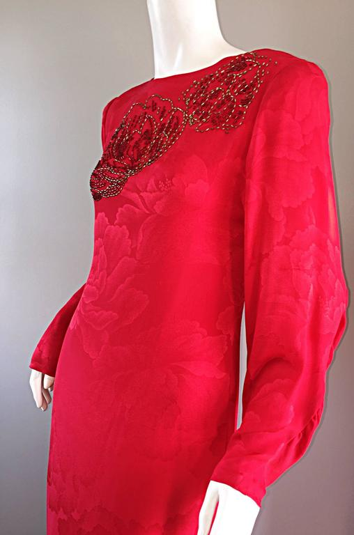 Absolutely beautiful vintage HANAE MORI lipstick red long sleeve column gown!  Wonderful shape, that looks amazing on! Luxurious silk, with a red floral theme throughout. Features POCKETS at both sides of the waist. Hand beaded detail at the bust