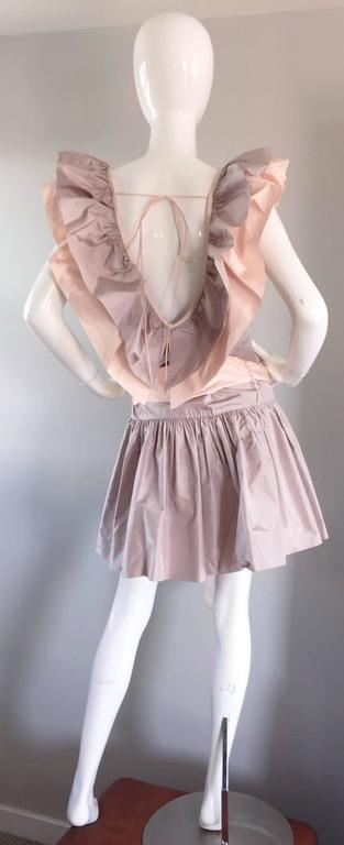 Amazing 1980s dress from hard to find designer CHRIS VAN WYK! Couture quality, with heavy attention to detail. Lavender body, with light pink sash that loops through on the drop skirt. Avant Garde pink and lavender ruffles on the front and back