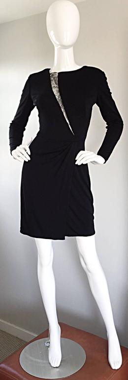 Featuring the perfect vintage little black dress by VICKY TIEL COUTURE! Black silk jersey, with ruching, and a lace cut-out (slash) down the bodice, that leaves just the right amount to the imagination. Incredible fit, that flatters the body like no