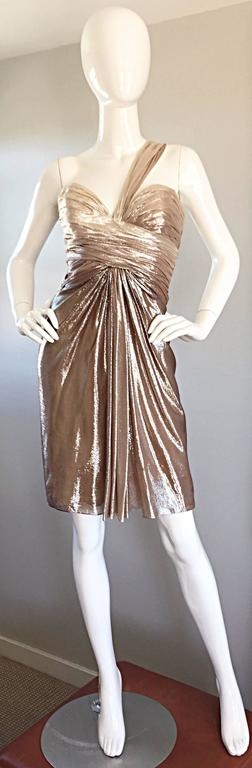 Gorgeous brand new PAMELLA ROLAND gold silk metallic ombre one shoulder Grecian dress! Features a light gold bodice, that gradually fades into a true gold skirt. Flattering pleating and ruching throughout, with a gorgeous sweetheart bust. Brand new,