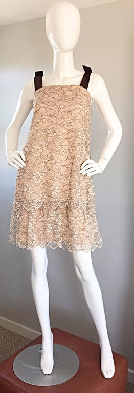 Beautiful 60s ANN BARRY taupe and brown Chantilly lace tiered A-Line / Shift dress! Chic brown silk ribbon sleeve straps, that feature a bow on each strap. Flattering shape, that easily hides any 'problem' areas. Full metal zipper up the back, with