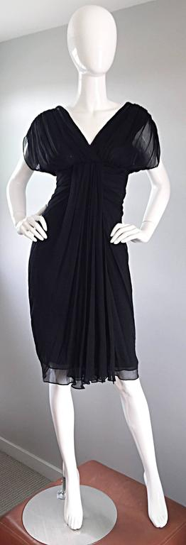 Beautiful DIANE VON FURSTENBERG black silk chiffon dress! Grecian inspired, with layers of black chiffon that literally flow with movement. Semi-sheer chiffon dolman sleeves. Sexy open peek-a-boo back, with snaps at top back neck. Hidden zipper