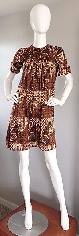 Rare and Wonderful vintage JOSEPH MAGNIN 60s tribal batik print 'ethnic' A-Line / trapeze dress! Flattering empire fit, with an equally impressive print. Buttons up the bodice, and looks great buttoned, or left unbuttoned. Zips up the back. Great