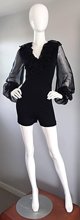 In all of my years of collecting vintage, I have never seen a piece quite like this 70s black stretch jersey playsuit / jumpsuit! Attributed to Mollie Parnis (original owner lost the label at dry cleaner years back. Only worn once!) Guaranteed