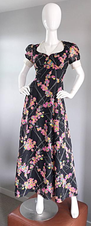 Wonderful vintage JOSEPH MAGNIN 70s does 30s black cotton short puff sleeve maxi dress! So much detail in this beauty! Features pink, blue and yellow flowers throughout, surrounded by white branches. White collar features crochet scalloped edges,