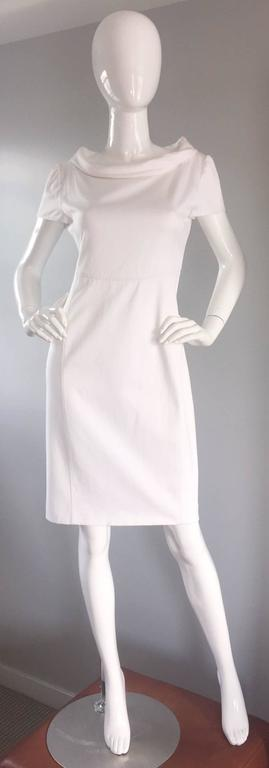 Brand new, never worn super chic VALENTINO stark white dress! Jackie O style, reminiscent of the 1960s. Flattering fit, with an equally flattering cowl neck. Cotton, with some stretch. Hidden zipper up the back, with three hook-and-eye closures at
