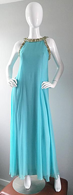 Beautiful vintage 60s LORD AND TAYLOR baby blue chiffon grecian inspired empire gown! Exquisite pale blue chiffon, that flows with movement. Stunning silhouette, with an impressive amount of attention to detail. Beaded rhinestone collar, and