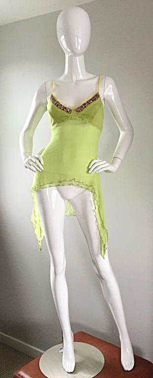 Exquisite ALEXANDER MCQUEEN chartreuse / lime green silk chiffon asymmetrical jeweled blouse! Brand new with original tags from 2004. Features hand-sewn colorful crystal rhinestones at bodice. Flowy layers of asymmetrical silk chiffon. Semi-sheer