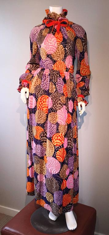 Sensational vintage GEOFFREY BEENE silk dress, with burnt-out silk velvet! Beautiful colors of purples, pinks, oranges, and taupe, that form an op-art polka dot print throughout. Full zip up the back, with two hook-and-eye closures at back neck.