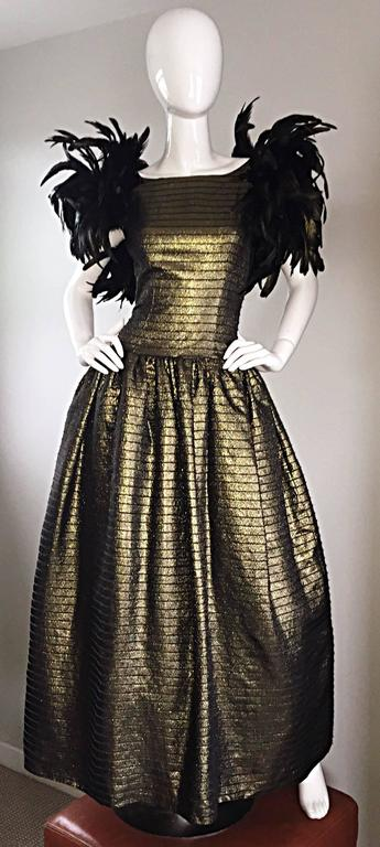 Absolutely incredible vintage VICTOR COSTA, for SAKOWITZ, golden bronze silk metallic evening dress! Features a wonderful full skirt, with built in crinoline. Avant Garde feathers at each sleeve. Low back, that reveals just the right amount of skin.