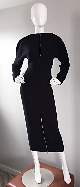 Important, and super rare vintage GEOFFREY BEENE minimalist 'zipper' ensemble! Features a black crepe top, with two vents on either side of the waist. Functional silver metal zipper up the front, which can also be left partially open. Avant Garde