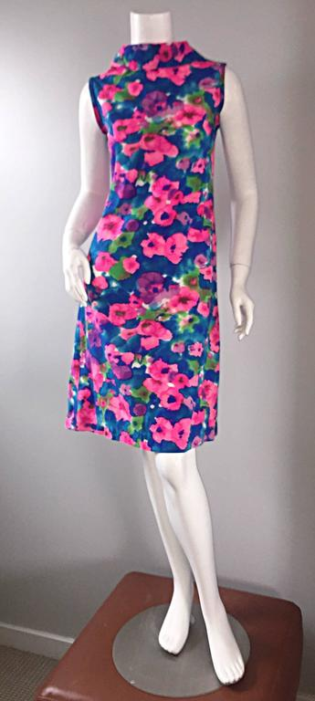 Chic 1960s watercolor floral dress! Beautiful vibrant colors of pink, purple, blue, green, and white, forming a wonderful floral watercolor print! Jackie-O style, with a high neck collar, and flared skirt. Luxurious cotton/silk blend, with a full