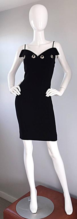Sexy vintage THIERRY MUGLER black bodycon dress! Not just your average little black dress! Impeccable tailoring that Mugler was renowned for. Silver dangling hoops adorn the bust. Silk velvet panels down each side of the dress. A timeless addition