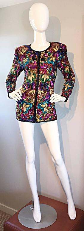 Sensational vintage silk jacket! Features thousands of hand-sewn sequins and beads throughout. Vibrant pops of color. Wonderful tailored fit, with hook-and-eye closures up the bodice. Features shoulder pads, which can easily be snipped out, if