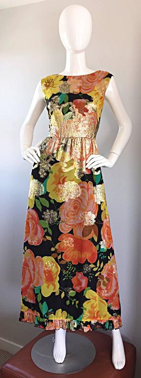 Incredible early 70s ALICE OF CALIFORNIA chiffon maxi dress! Beautiful floral prints, with gold metallic print at waist and sporadically throughout. Looks amazing on, and can also be belted. Excellent tailoring, with a ruffled hem. Full metal zipper