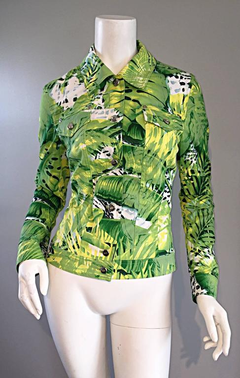 Amazing brand new ESCADA cotton jacket! Denim style, with banana leaves and palm trees printed throughout in vibrant hues of green. Silver buttons, embossed discreetly with the Escada logo, down the bodice, at each from breast pocket, and at each
