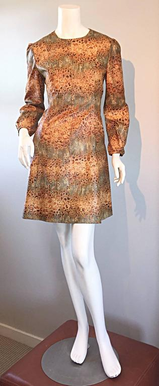 Awesome 1960s reptile print dress! Incredible alligator/crocodile print, mixed with a snake/lizard print. Wonderful flattering A-Line fit. Bubble sleeves, with elastic at each wrist cuff. Full metal zipper up the back. Very well made. Looks great