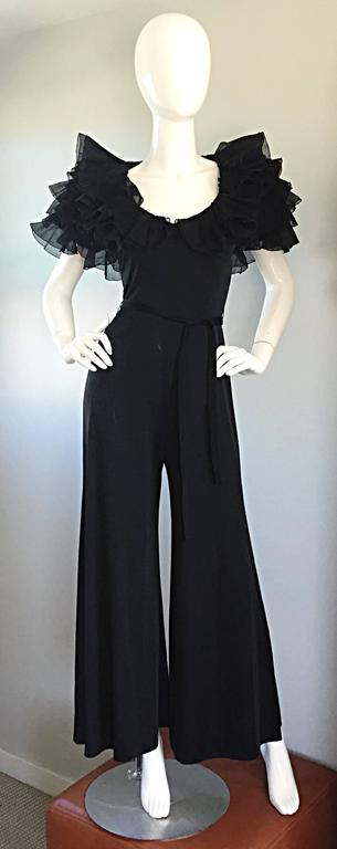Exquisite late 70s / 1970s (early 1980s / 80s) MIGNON black jersey jumpsuit! Features a figure flattering stretch to fit silk jersey material, with black silk chiffon tiered ruffle sleeves. Hidden zipper up the back, with hook-and-eye closure. Avant