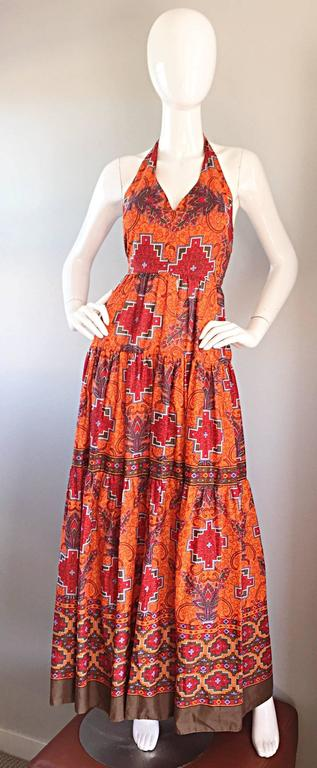 Fantastic vintage FRANK USHER 70s lightweight cotton maxi halter dress! Amazing tribal / southwestern / ethnic print throughout. Burnt orange background, with contrasting multicolored prints throughout. Metal zipper up the back, with hook-and-eye