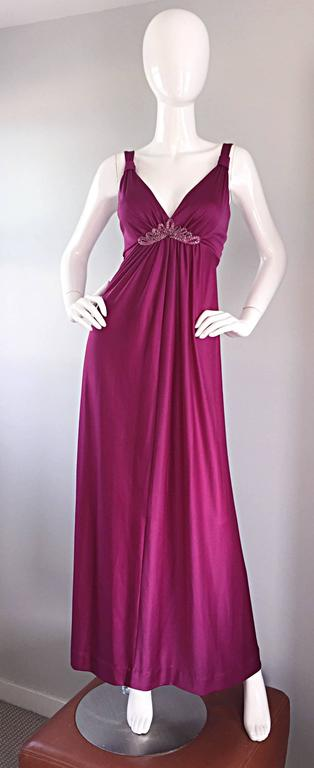 Sexy 1970s wine colored Grecian maxi dress, and matching shrug! Slinky maxi dress, with beading detail at the bust. Flattering gathers throughout the bodice, which not only look good, but leave some room to breathe! Full metal zipper up the back,