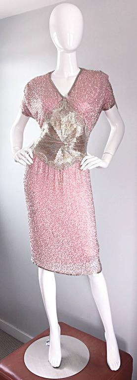 Gorgeous vintage OLEG CASSINI heavily beaded pink silk dress! Luxurious layers of pink silk and chiffon encrusted with thousands of hand-sewn silver beads. Absolutely stunning on! Drapes the body like a gem, and waist features slimming beadwork.