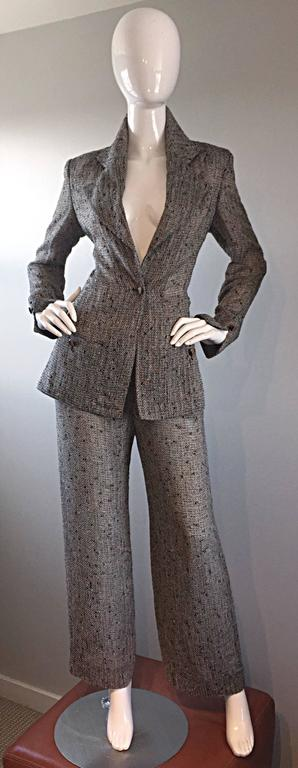 Simply amazing vintage JEAN-LOUIS SCHERRER couture numbered fitted trouser suit. Features a smart slim fitting blazer, with one button up the bodice. Signature wide lapels, and two functional pockets at each waist. Signed Scherrer wood buttons at
