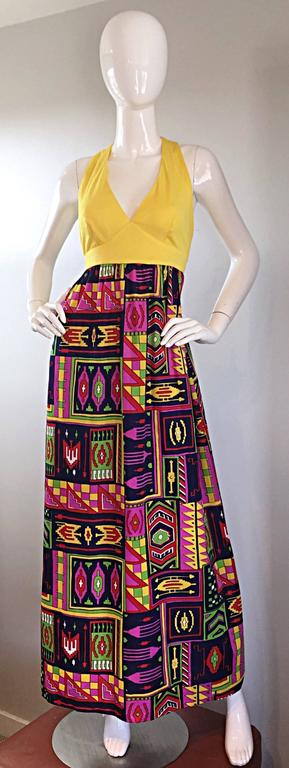 Incredible 70s KELLY ARDEN maxi dress and fringed shawl! Dress features a 'caged' back, with two gold buttons at top back neck. Halter style. Full skirt features bright colors in an abstract 'Southwestern' print. Full zipper up the back, with