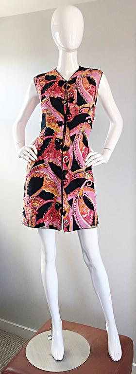 Awesome vintage 60s retro silk 'Asian' themed long silk vest or mini dress! Features a psychedelic print of pink, fuchsia, black, orange, red, brown and black throughout. Intricate silk Asian buttons down the bodice. Fully lined. Vents at both sides