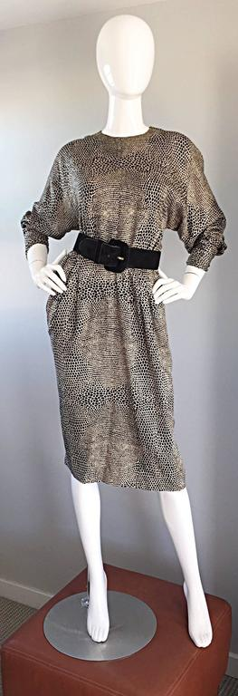 Striking vintage ADELE SIMPSON for NEIMAN MARCUS black and ivory tejus lizard print dress! Features flattering dolman sleeves, which can accommodate an array of bust sizes. Sleek tailored sleeves, with snaps at each cuff to ensure a proper fit at