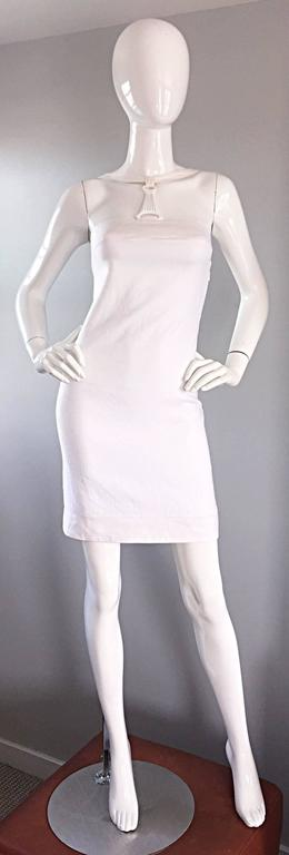 Sexy rare vintage GIANNI VERSACE white bondage linen dress! Flattering BodyCon fit that does wonders for the body! Fully lined. Features a white metal 'harness' with signature Medusa head. Multiple hidden snaps to fasten the harness at neck. Hidden