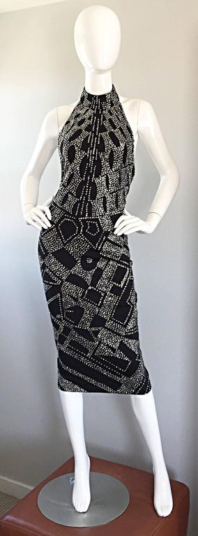 Rare beauty from Bob Mackie's early work! Sexy 70s BodyCon fit, with a stretch to fit double faced jersey material. Features all over silver glitter (not the kind that gets everywhere) with a trompe l' oeil effect. Halter neck, with an open back.