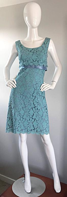 Exceptionally beautiful 60s vintage demi-couture light blue silk lace dress! Features the most beautiful french lace overlay, with an attached light blue silk dress. Silk satin ribbon detail at waist. Full metal zipper, with snaps and hook-and-eye