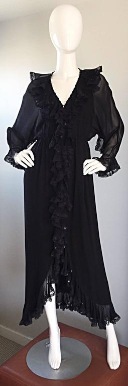 Absolutely insanely gorgeous vintage 1970s BILL BLASS black silk chiffon long sleeve dress! Features intricately detailed silk lace ruffles down the front of the dress, sleeves and collar. Semi sheer chiffon sleeves. Demi couture quality, with
