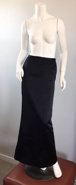 Sensational vintage OSCAR DE LA RENTA black silk satin full length evening maxi / trumpet hem skirt! Impeccably designed, by the late great de la Renta! Sleek flattering fit hugs the body in all the right places, then flares out at the hem. Hidden