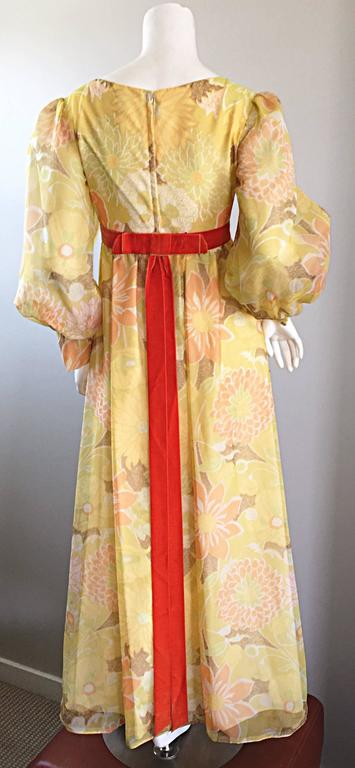 Gorgeous vintage 70s EMMA DOMB yellow chiffon long sleeve maxi dress! Primary yellow color, with pastel pink, green, orange and white flowers printed throughout. Burnt orange velvet attached belt that is longer in the back. Semi sheer chiffon bishop