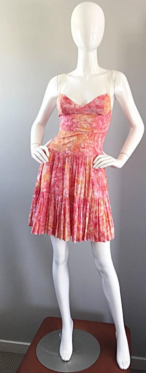 Adorable TRACY FEITH pink, orange and white swirled watercolor print cotton tiered dress! Features tan rope spaghetti straps. Fitted bodice with a tiered ruffle hem. Incredible ode to the 50s with a whimsical flare.Hidden zipper up the back with