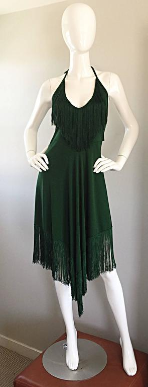 Absolutely smashing 70s DAVID HOWARD deep green halter fringe dress! There are so many incredible details to this gem that I do not even know where to begin! Halter neck with a cut-out (peek-a-boo) back. Fringe detail at bust and at handkerchief
