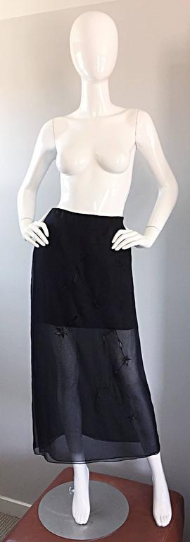 Beautiful brand new with tags ALBERTA FERRETTI 90s vintage black silk mini skirt with attached embroidered chiffon overlay! Features crochet embroidery throughout the front and back of the chiffon overlay. Overlay features two layers of the softest