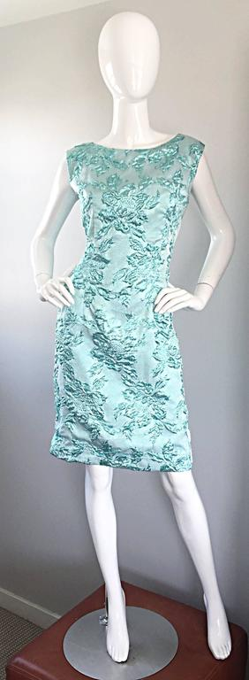 Beautiful bombshell of a 1960s vintage wiggle dress! The perfect little late 1950s / 50s early 60s dress! Beautiful silk lurex fabric with a great fit! Super flattering fit. Full metal zipper up the back with hook-and-eye closure. In great