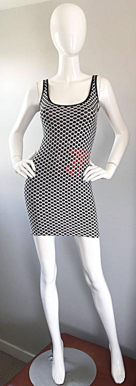 Sexy 1990s GIANFRANCO FERRE black and white fishnet mini dress! Black cotton jersey with white fishnet. Red hand-sewn seed beads at side waist subtly spell out the GFF logo. Classic bodcon fit that is super flattering on the body. Perfect with heels