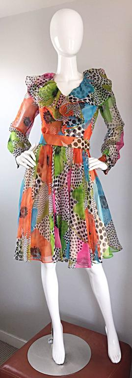 Incredible 1970s JACK BRYAN chiffon ruffle dress! Features neon flowers and black and white polka dots throughout. Vibrant neon colors of green, blue, pink, and orange. Chic chiffon ruffles at bodice. Detachable belt.Semi sheer chiffon sleeves with
